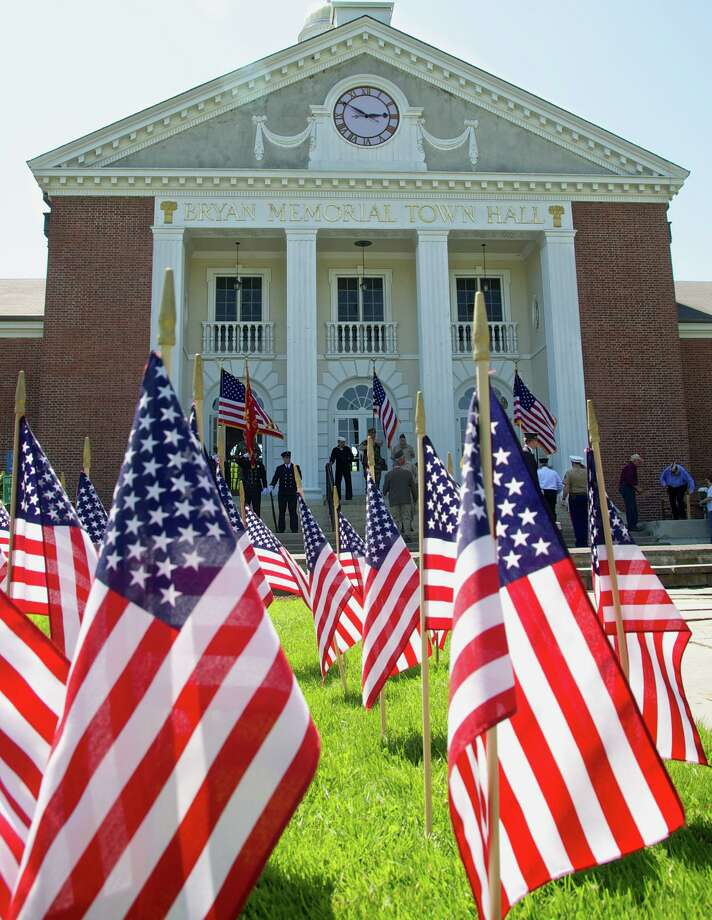 A Field of Flags honoring the men and women of the nation's armed services will grace the lawn fronting Bryan Memorial Town Hall in Washington Depot. Photo: Trish Haldin / Trish Haldin / Trish Haldin