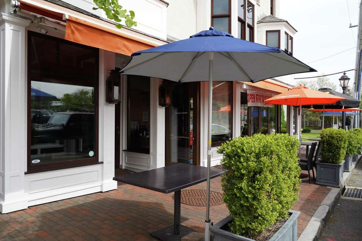 New Canaan has started to reopen stores on Wednesday, May 20, but dining outside of restaurants is going to wait until Friday, May 22. Many owners have signs asking patrons to wear masks as they reopen amid the coronavirus pandemic.