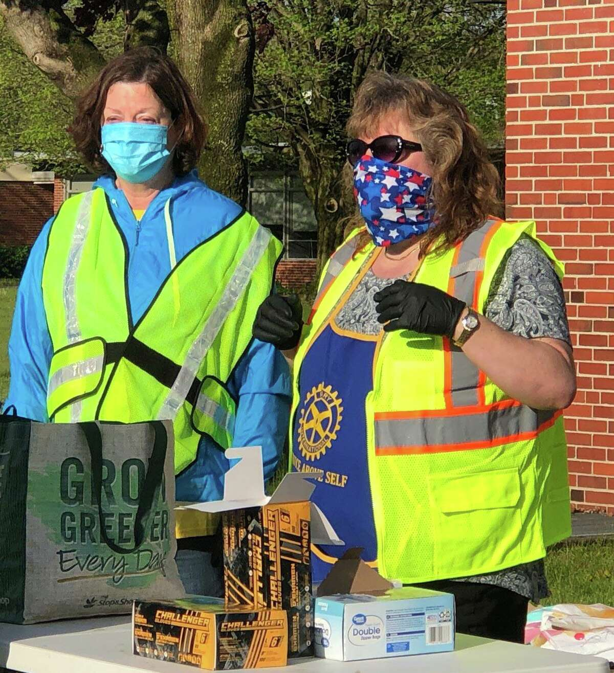 Rotarians Sharon Ward, left, and co-coordinator of the event Lori Gordon, oversee the tables to replenish stock.