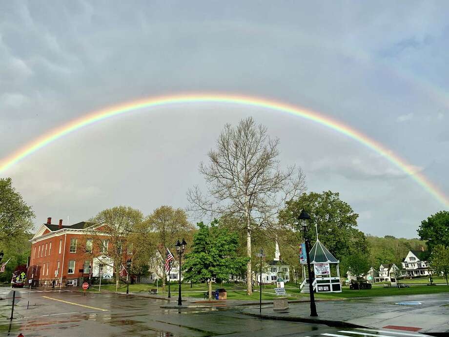 The beauty of the New Milford Village Green always seems to shine. But last Friday the town's downtown charm was magnified beneath a double rainbow that appeared after a rain shower. Photo: Courtesy Of Tony Vengrove / Danbury News Times