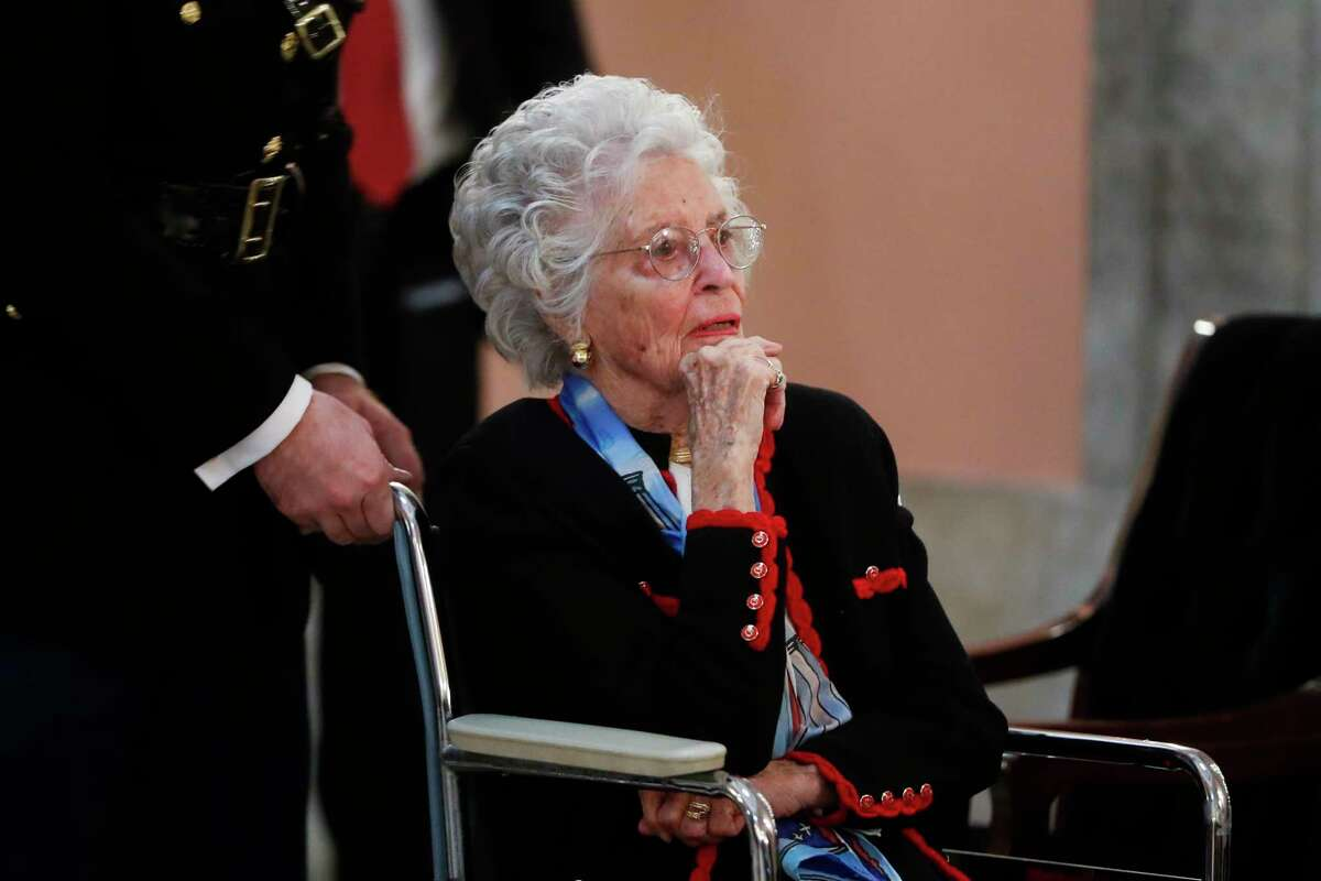 FILE - In this Dec. 16, 2016 file photo, Annie Glenn arrives to view the casket of her husband famed astronaut John Glenn as he lies in honor, in Columbus, Ohio. Glenn, the widow of astronaut and U.S. Sen. John Glenn and a communication disorders advocate, died Tuesday, May 19, 2020, of COVID-19 complications at a nursing home near St. Paul, Minn., at age 100. (AP Photo/John Minchillo, File)
