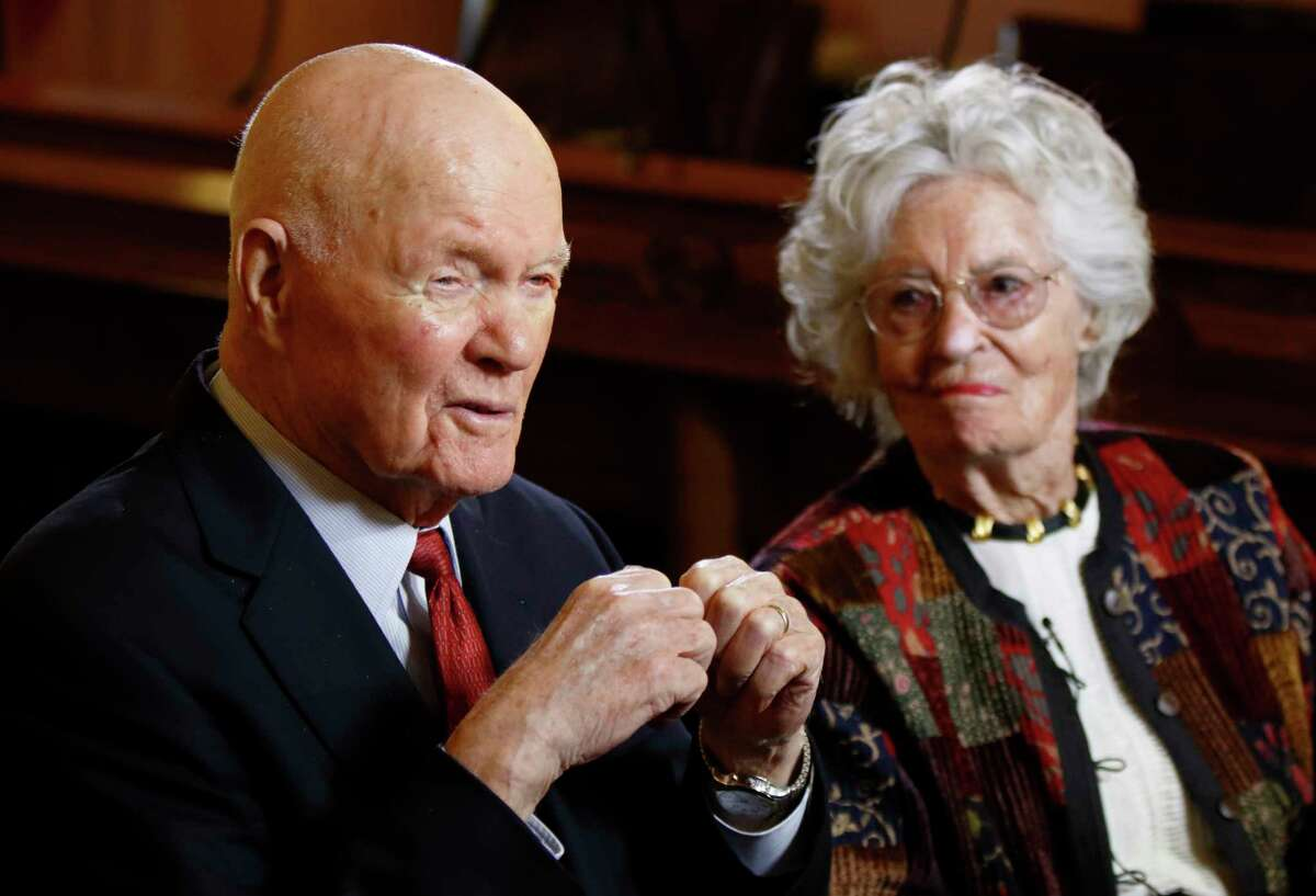 FILE - In this May 14, 2015, file photo, former astronaut and U.S. Sen. John Glenn, D-Ohio, left, answers questions with his wife Annie Glenn during an interview with The Associated Press at the Ohio Statehouse in Columbus, Ohio. Glenn, the widow of John Glenn and a communication disorders advocate, died Tuesday, May 19, 2020, of COVID-19 complications at a nursing home near St. Paul, Minn., at age 100. (AP Photo/Paul Vernon, File)