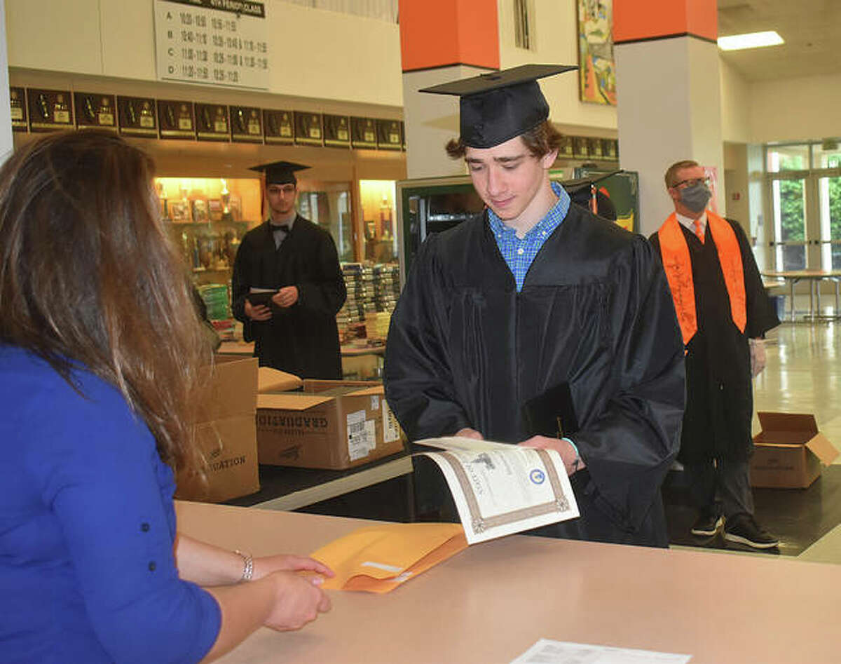 Seniors have the opportunity this week to pick up their diplomas, honor cord(s) and awards from EHS and pose with Principal Dr. Dennis Cramsey in their caps and gowns inside Lucco-Jackson Gymnasium during a drive-through graduation ceremony. The five-day event started Monday morning and Tuesday afternoon and will continue from 4 p.m. to 6 p.m. on Wednesday and 9 a.m. to 11 a.m. on Thursday and Friday.