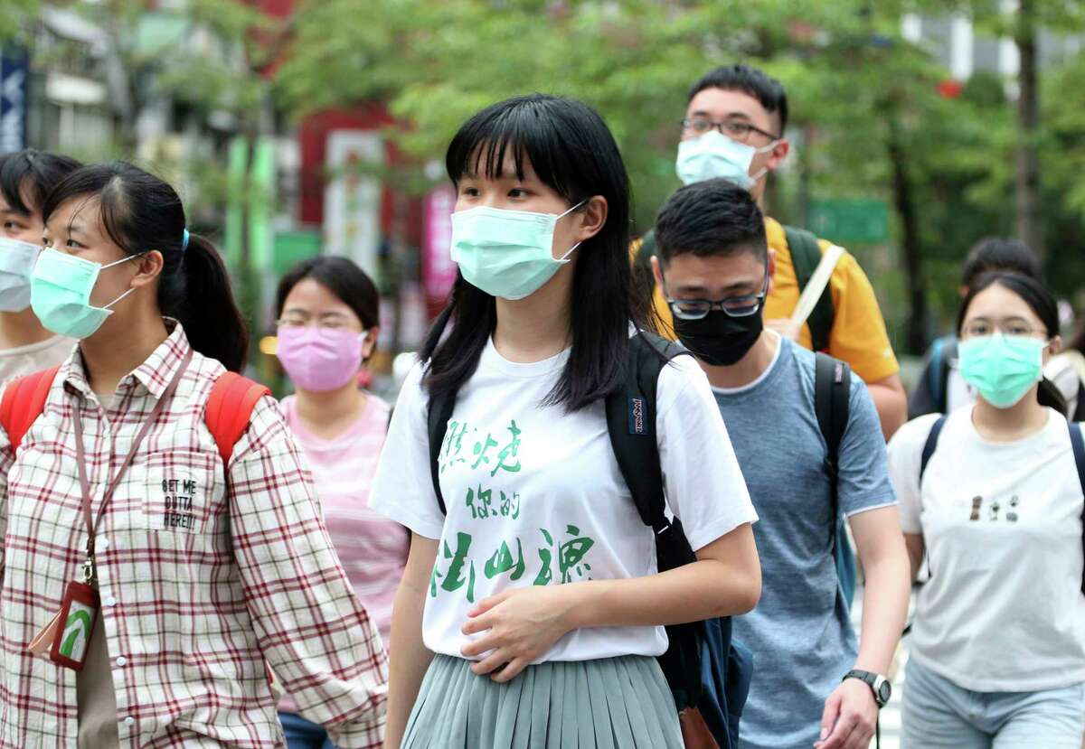 Face mask use is virtually universal in Taiwan, one of the countries least impacted by COVID-19 due to interventions. (Shown: Taipei street on May 18, 2020.)