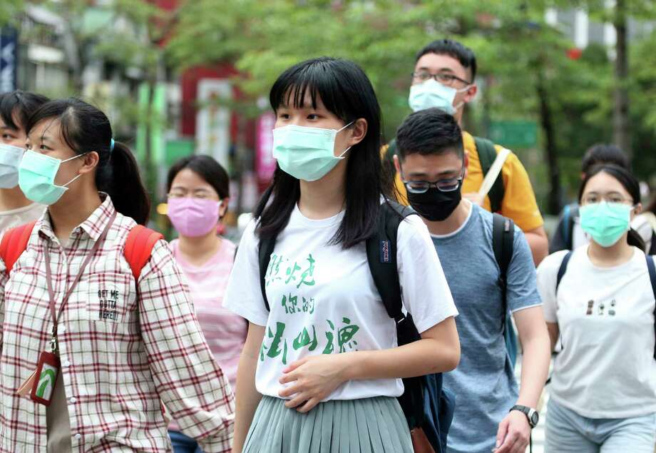 Face mask use is virtually universal in Taiwan, one of the countries least impacted by COVID-19 due to interventions. (Shown: Taipei street on May 18, 2020.) Photo: Chiang Ying-ying, AP / Copyright 2020 The Associated Press. All rights reserved.