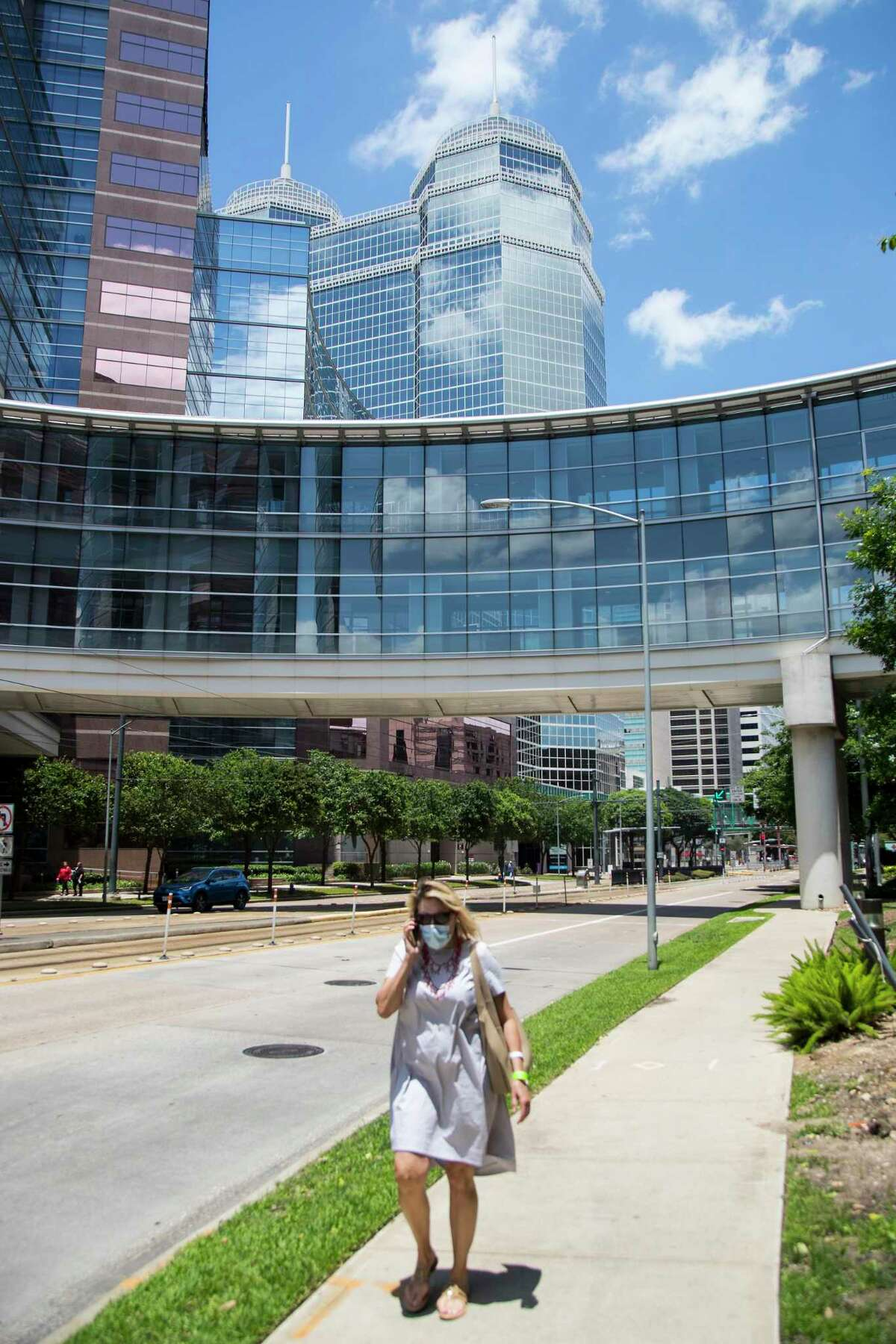 """People move about the Texas Medical Center on Tuesday, May 19, 2020 in Houston. Texas Medical Center leaders Tuesday defended the latest stage of Gov. Greg Abbott's reopening of the economy, arguing that though they disagree with some of the calls, it's a reasonably cautious approach given the tightrope he needs to walk. The leaders, who supported Harris County Judge Lina Hidalgo's more hard line attitude during the lockdown, said Tuesday they like Abbott's staged opening and pause to look at data. Some academics took a different view, however. Rice University health economist Vivian Ho called Abbott's moves too fast and said """"it's a disaster in the making."""""""