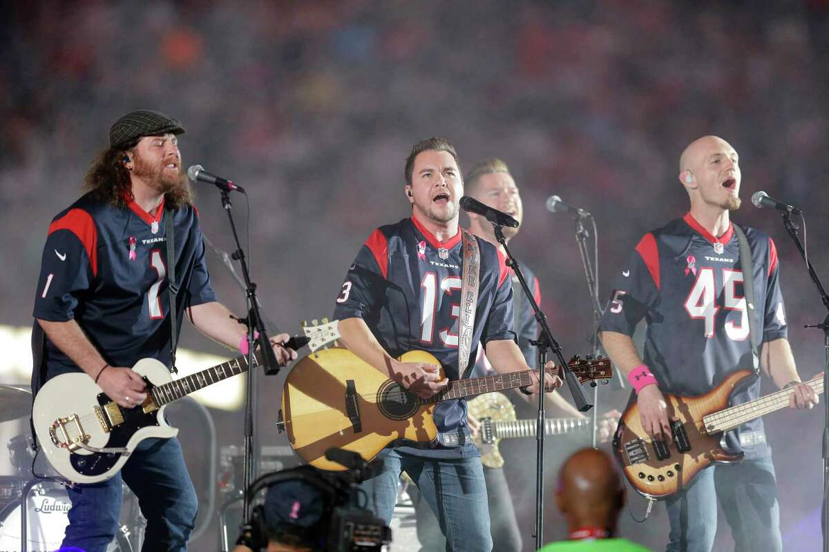 FILE - This Oct. 9, 2014 file photo shows The Eli Young Band performing during halftime of an NFL football game in Houston. The band will perform as part of the Concert in Your Car series at the new Texas Rangers stadium ,Globe Life Field, in Arlington, Texas starting June 4. (AP Photo/Patric Schneider, File)