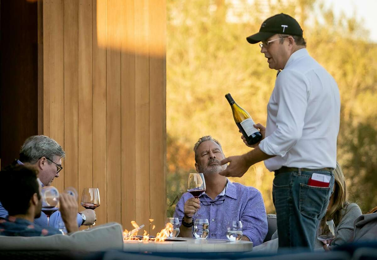 Brian Alllard pours wine for customers at the Bouchaine Winery tasting room in Napa, Calif. on November 9th, 2019.