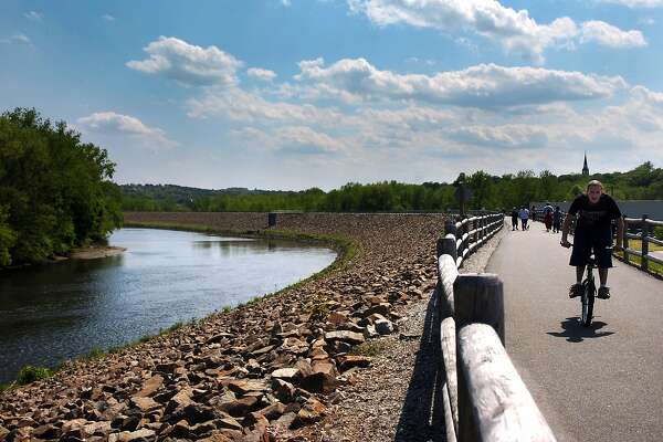 People walk and bike along the Riverwalk overlooking the Naugatuck River in Ansonia Conn. in May of 2008.