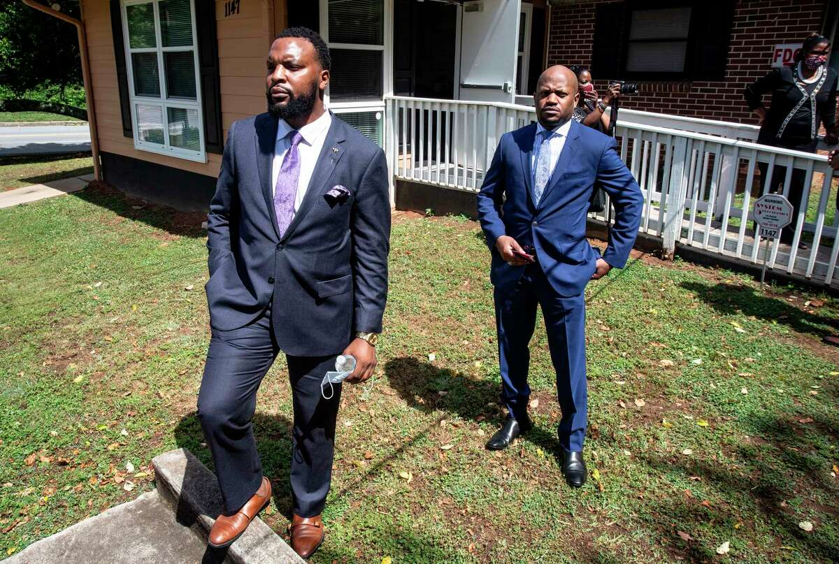 Lee Merritt, left, and Chris Stewart, attorneys for the mother of Ahmaud Arbery, are seen at a news conference on Wednesday, May 19, 2020, in East Point, Georgia. The attorneys appeared and spoke at a news conference held by the Atlanta branch of the NAACP. After a video of the shooting of Arbery emerged on social media, the Georgia Bureau of Investigation, arrested Gregory McMichael, 64, and his son, Travis McMichael, 34, and they were jailed on murder and aggravated assault charges. (AP Photo/Ron Harris)