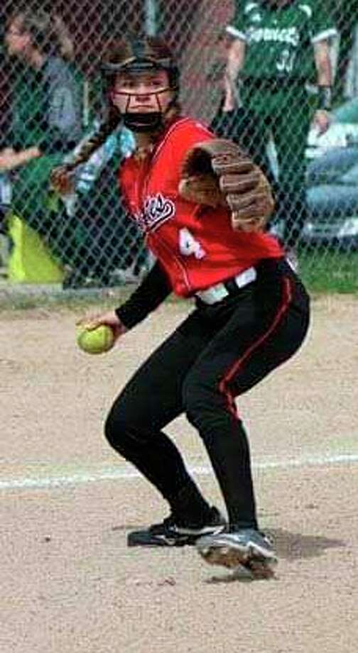 Reed City's Mia Petersen gets set to throw the ball from third base during action last year. (Courtesy photo)
