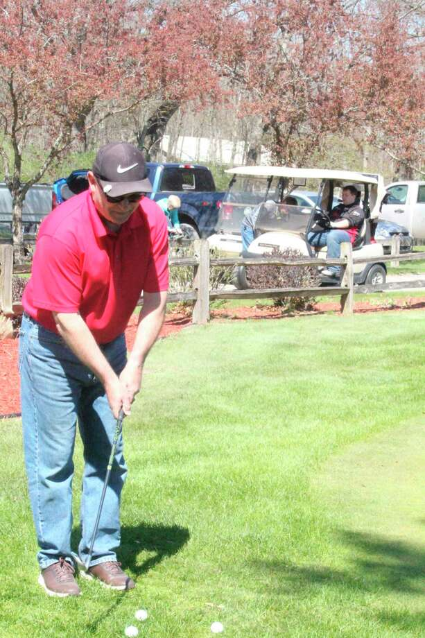 Tim Webster practices his chipping at Marquette Trails Golf Course last week. (Herald Review photo/John Raffel)