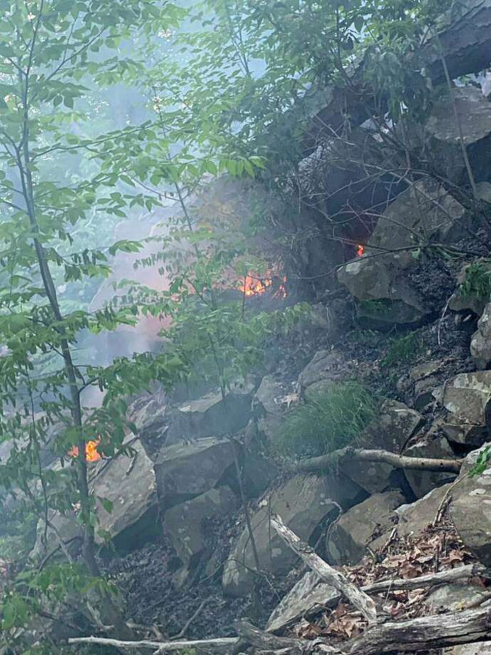Hamden firefighters battled a brush fire at Sleeping Giant State Park on Tuesday, May 19, 2020. Fire Chief Gary Merwede said the fire was reported by Quinnipiac University security who saw smoke near the chin area the mountain. Photo: Hamden Fire Department Photo