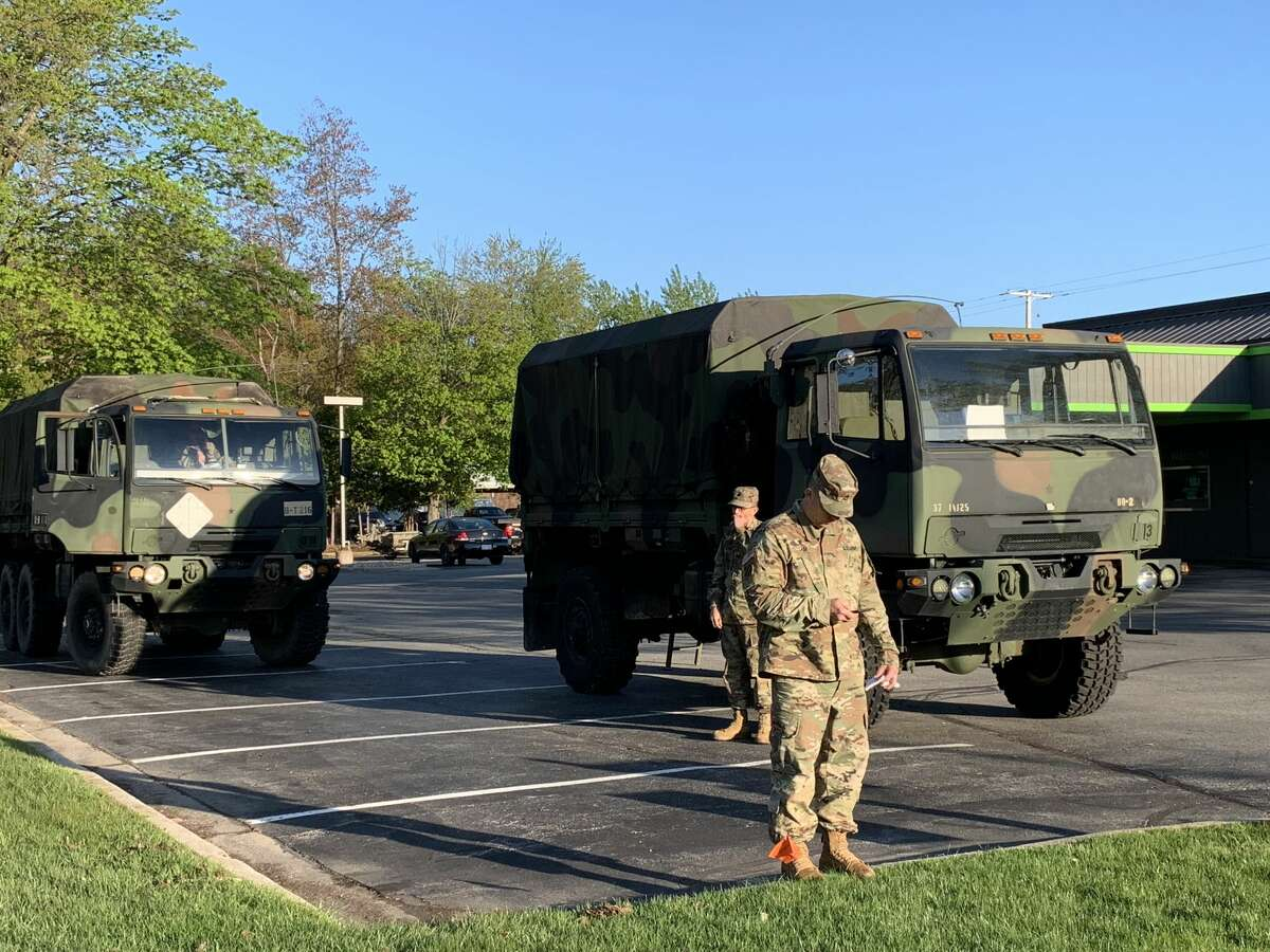 Emergency responders, including the Midland Fire Department, the Michigan State Police, and the National Guard gather in the parking lots at the intersection of Eastman and Saginaw Road in Midland early Wednesday morning.