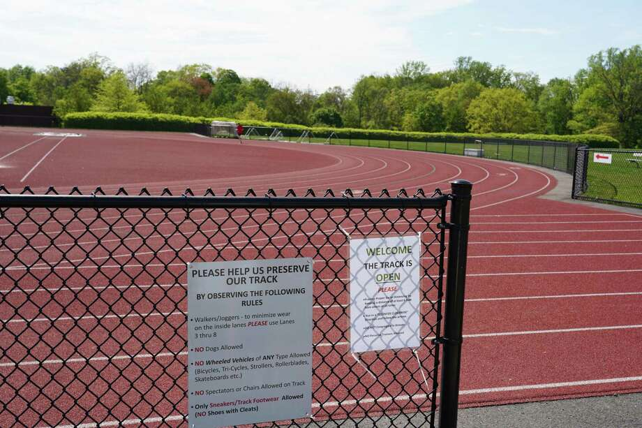The track in New Canaan has reopened after being closed for the pandemic. New arrows point in one direction and there are other new rules on the sign as one enters, as of May 18. Photo: Grace Duffield / Hearst Connecticut Media