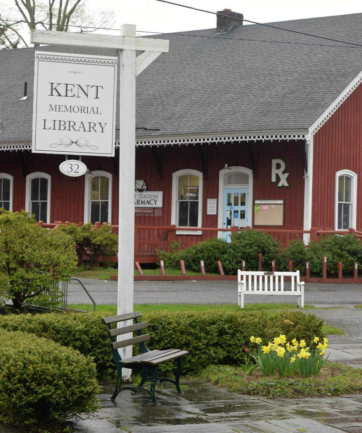 Sign and bench for the Kent Memorial Library in downtown Kent, Conn., Thursday, April 30, 2020.