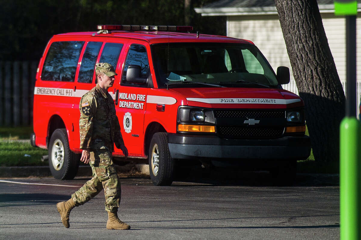 Police, firefighters and members of national guard are headquartered at Midland Fire Station #3 as they go out in two hour shifts to assist residents affected by severe flooding Wednesday, May 20, 2020 in Midland. (Katy Kildee/kkildee@mdn.net)