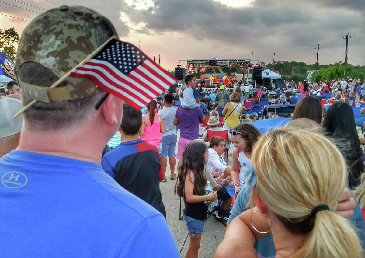 Visitors celebrate Independence Day at the Tomball July 4th Celebration and Street Fest.