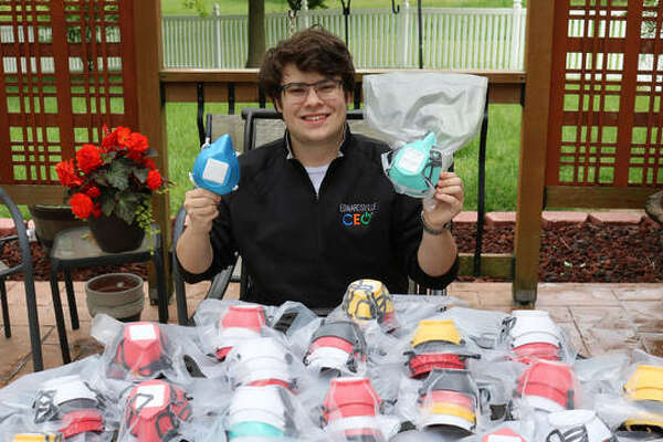 Edwardsville High School senior Sam Lewis displays some of the masks he has made with a 3D printer as part of The Mask Project Edwardsville.