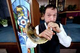 Rabbi Jon-Jay Tilsen demonstrates blowing a shofar at Congregation Beth-El Keser Israel in New Haven in 2017.