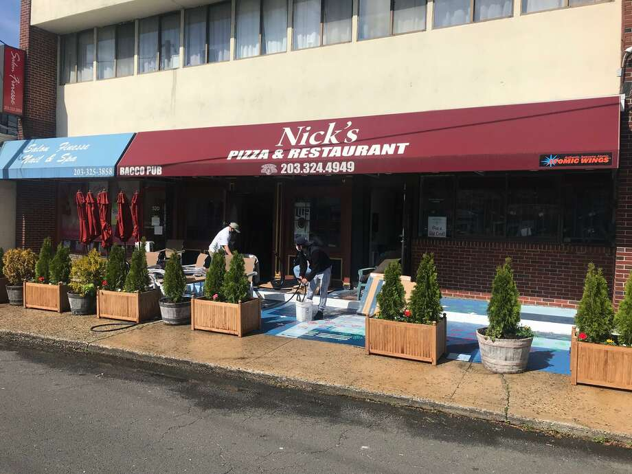 Nick's Pizza owner Maria Criscuolo said she was not expecting too many customers on this first day that Stamford is opening up restaurants like hers to outdoor seating on Wednesday, May 20, 2020. Photo: John Nickerson /Hearst Connecticut Media
