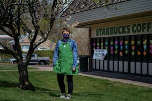 """Riley Breakell, a Starbucks employee who said she was """"very anxious"""" about going back to work last week, in Farmington, Conn., May 9, 2020. As business restrictions are lifted, employees have moved from advocating workplace safeguards to making sure the measures aren't removed too soon. (Monica Jorge/The New York Times)"""