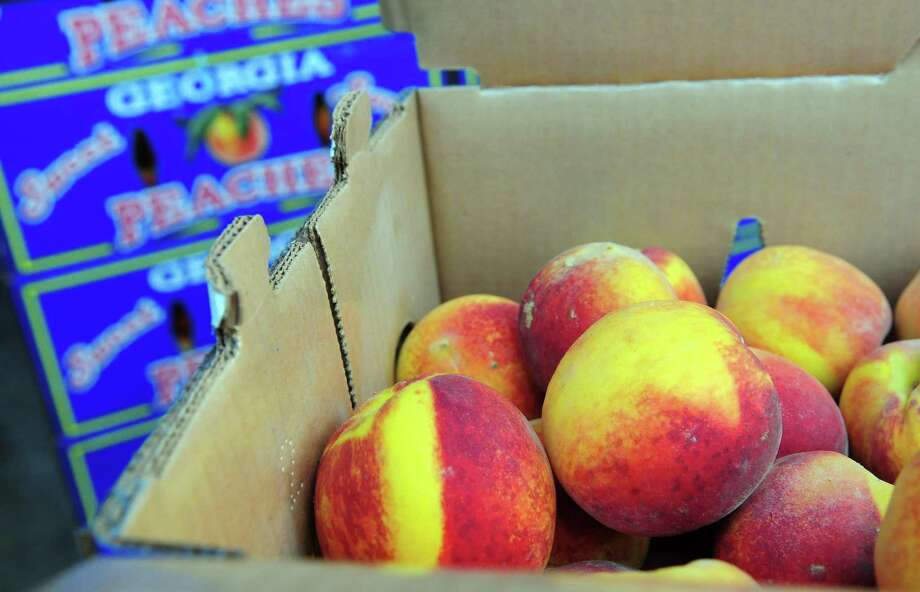 The Peach Truck will make three San Antonio area stops on June, featuring 25-pound boxes of Georgia peaches for $43. Photo: Christian Abraham /Hearst Connecticut Media / Connecticut Post