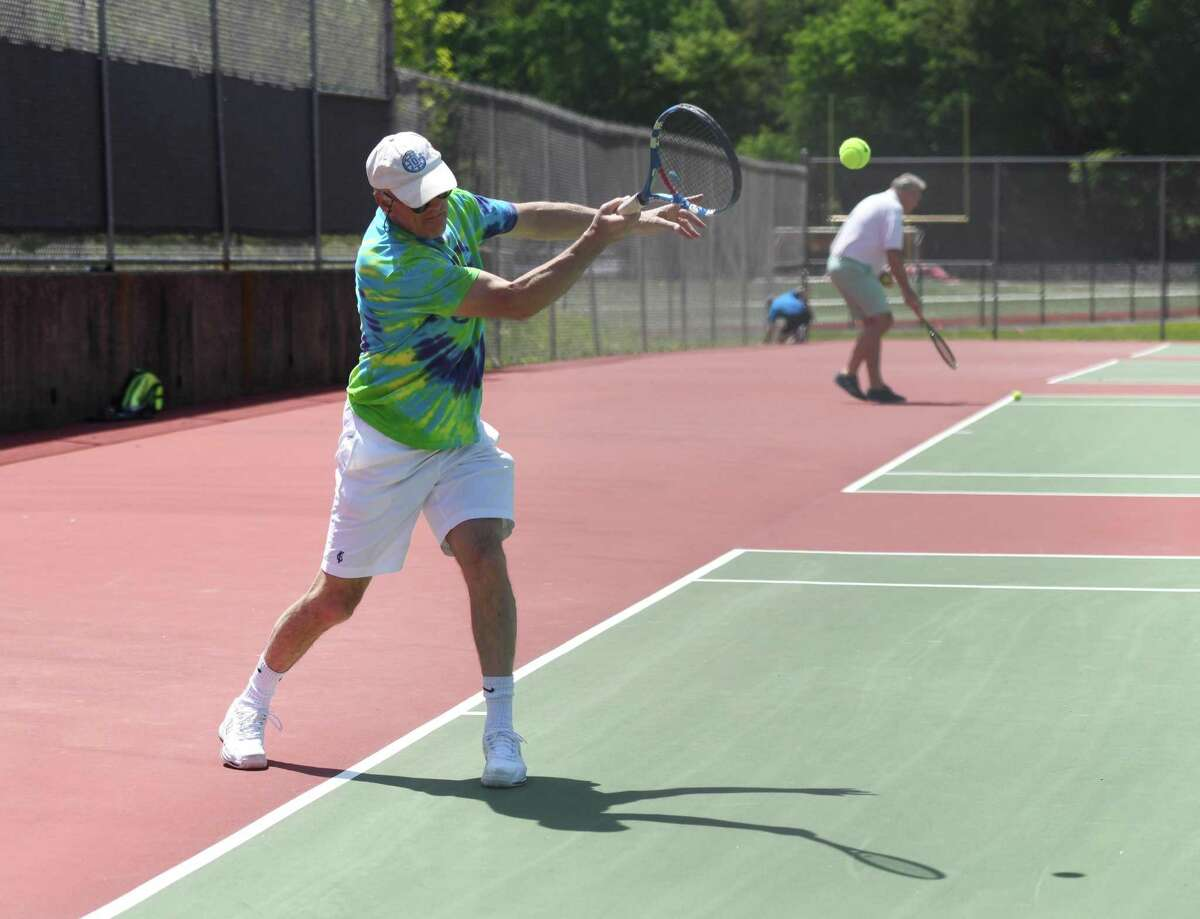 Riverside's Bill Drake plays tennis on the courts at Greenwich High School in Greenwich, Conn. Sunday, May 17, 2020. The town's tennis courts reopened on May 15 with many restrictions including mandatory social distancing and no doubles play.