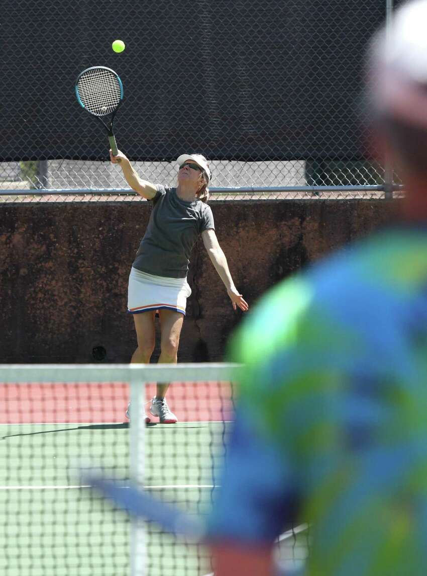 Riverside's Annie Drake plays tennis on the courts at Greenwich High School in Greenwich, Conn. Sunday, May 17, 2020. The town's tennis courts reopened on May 15 with many restrictions including mandatory social distancing and no doubles play.