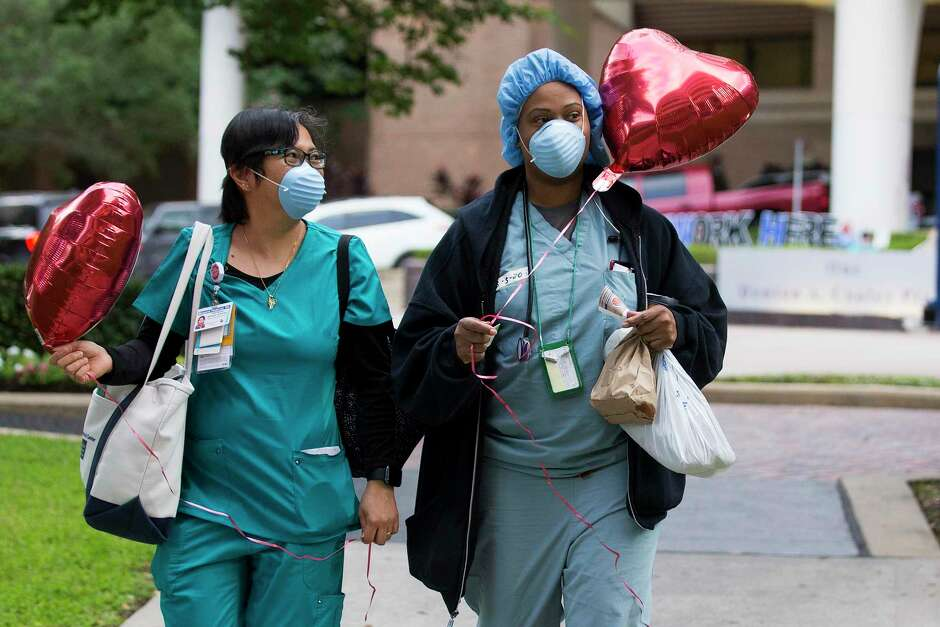 Registered nurse Margaret Padernal, left, and respiratory therapist Rena Boutte carry balloons they were given as they left work on Wednesday, May 6, 2020 at CHI St. Luke's Health - Baylor St. Luke's Medical Center in Houston. In honor of National Nurses Week and kicking off on National Nurses Day, Party City surprised the hospital's night shift nurses as they got off work.