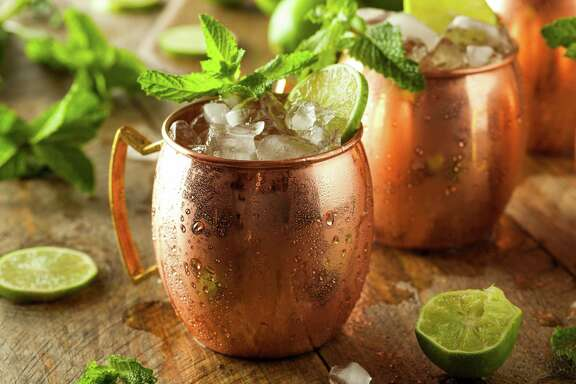 The Moscow Mule doesn't have to be served in a traditional copper cup, but the vessel helps keep the union of vodka, lime and ginger beer ice cold.