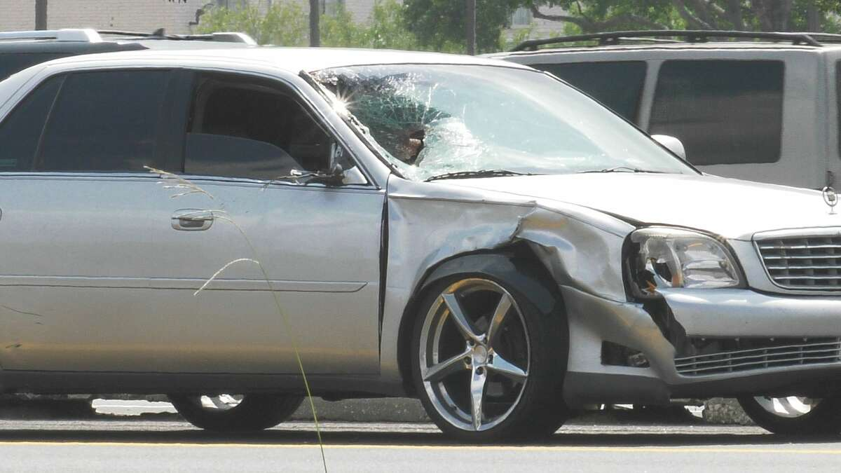Houston police investigate a deadly auto-pedestrian colission along the Southwest Freeway near Fondren Road on Wednesday, May 20, 2020.