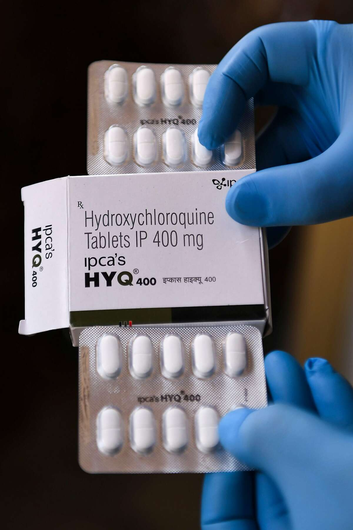 (FILES) In this file photo taken on April 26, 2020 a vendor shows hydroxychloroquine (HCQ) tablets at a pharmacy in Amritsar. - Brazil's health ministry recommended on May 20, 2020 using chloroquine and hydroxychloroquine to treat even mild and moderate cases of COVID-19, something President Jair Bolsonaro has pushed for despite a lack of conclusive evidence of their effectiveness. (Photo by NARINDER NANU / AFP) (Photo by NARINDER NANU/AFP via Getty Images)
