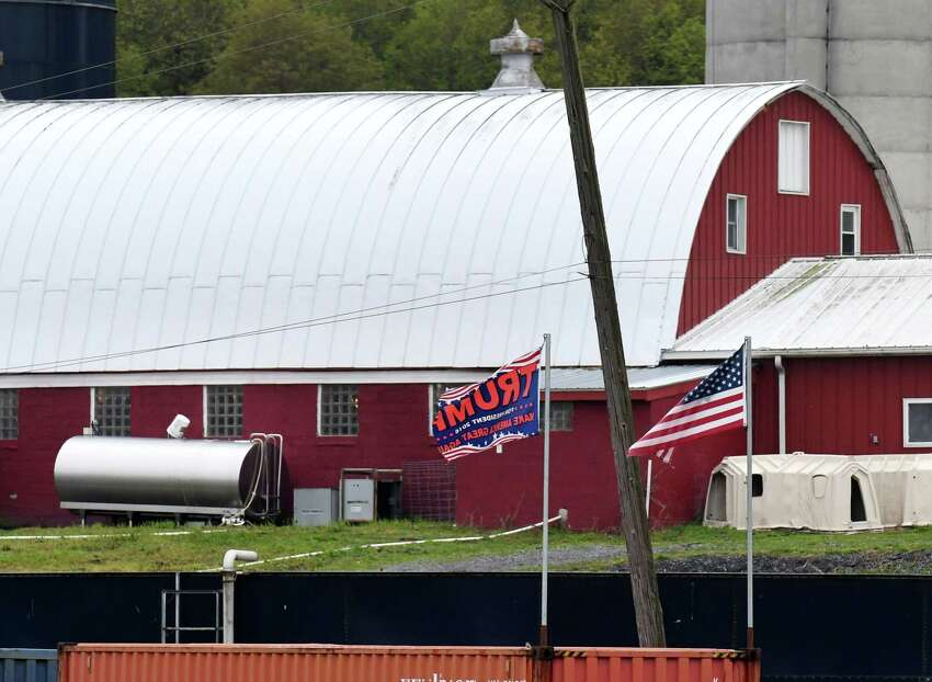 Exterior of the Meadowbrook Farms Dairy on Monday, May, 18, 2020, in Clarksville, N.Y. For some customers, the farm's flags in support of President Trump are controversial. (Will Waldron/Times Union) (Will Waldron/Times Union)