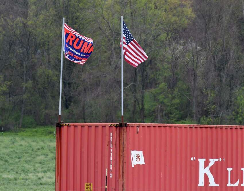 Pro-Trump flags are flown at Meadowbrook Farms Dairy on Monday, May, 18, 2020, in Clarksville, N.Y. The local dairy farm is running low on returnable bottles used to deliver their products. A contentious debate erupted on the Honest Weight Food Co-op Facebook page when an appeal to return bottles was posted. Some people took exception pro-Trump flags being flown at the farm. (Will Waldron/Times Union)