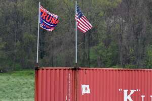 Pro-Trump flags are flown at Meadow Brook Farms Dairy on Monday, May, 18, 2020, in Clarksville, N.Y. The local dairy farm is running low on returnable bottles used to deliver their products. A contentious debate erupted on the Honest Weight Food Co-op Facebook page when an appeal to return bottles was posted. Some people took exception pro-Trump flags being flown at the farm. (Will Waldron/Times Union)