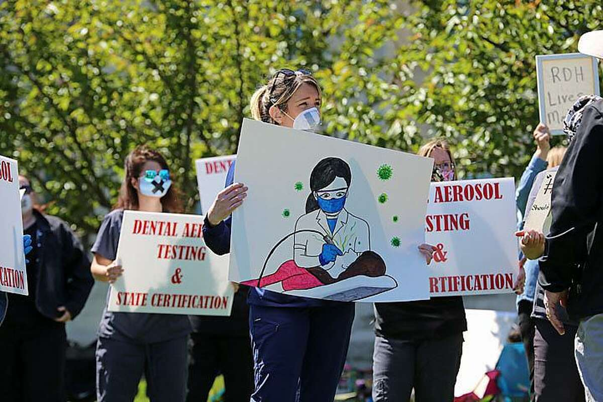 Meg Zadrowski, a dental hygienist, participates in Wednesday's protest in Hartford.