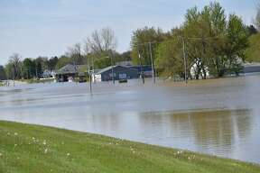 Flood water rises along Poseyville Road as the Tittabawassee River floods Wednesday, May 20, 2020.