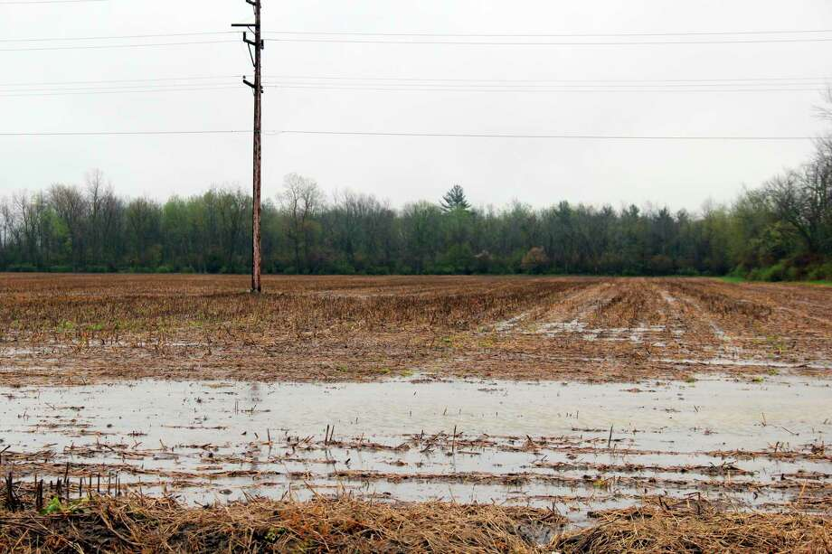 While the Upper Thumb avoided the heaviest rain that caused substantial flooding in Midland County and elsewhere around the state, many of the fields are left fully saturated and underwater. (Robert Creenan/Huron Daily Tribune)