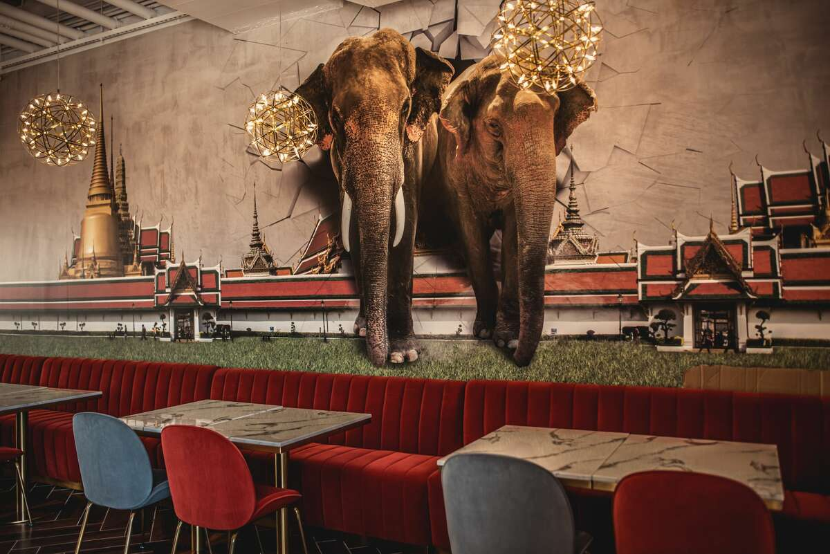 The 2,500 square-foot space with 77 seats was designed by Srasrisuwan. The interior features pops of red inspired by the Thai chili pepper, an eye-catching elephant mural and patio that accommodates an additional 20.