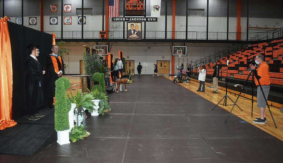 Four stages were set up inside Lucco-Jackson Gymnasium, including one that allowed seniors to have their picture taken with Edwardsville High School Principal Dr. Dennis Cramsey.