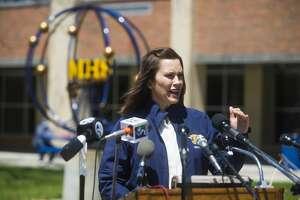 Gov. Gretchen Whitmer addresses members of the media and Midland County residents during a press conference at the temporary shelter at Midland High School Wednesday, May 20, 2020. Whitmer spoke of response efforts to severe flooding caused by dam failures upstream of the Tittabawassee River. (Katy Kildee/kkildee@mdn.net)