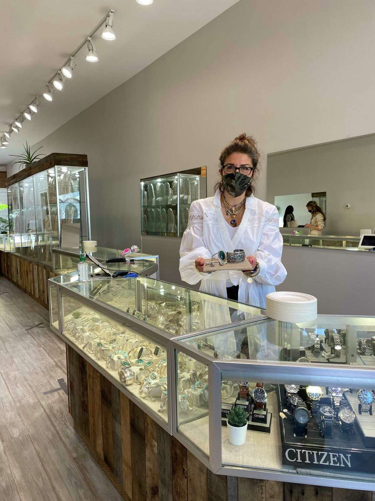 Angela Sugarella displays jewelry at Pennyweights in downtown New Canaan, open for business as of Wednesday, May 20, after being closed since March due to the coronavirus pandemic.