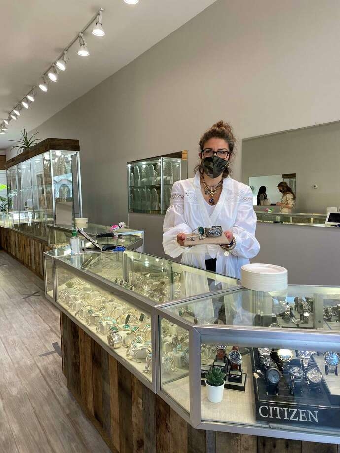 Angela Sugarella displays jewelry at Pennyweights in downtown New Canaan, open for business as of Wednesday, May 20, after being closed since March due to the coronavirus pandemic. Photo: Grace Duffield / Hearst Connecticut Media / New Canaan Advertiser