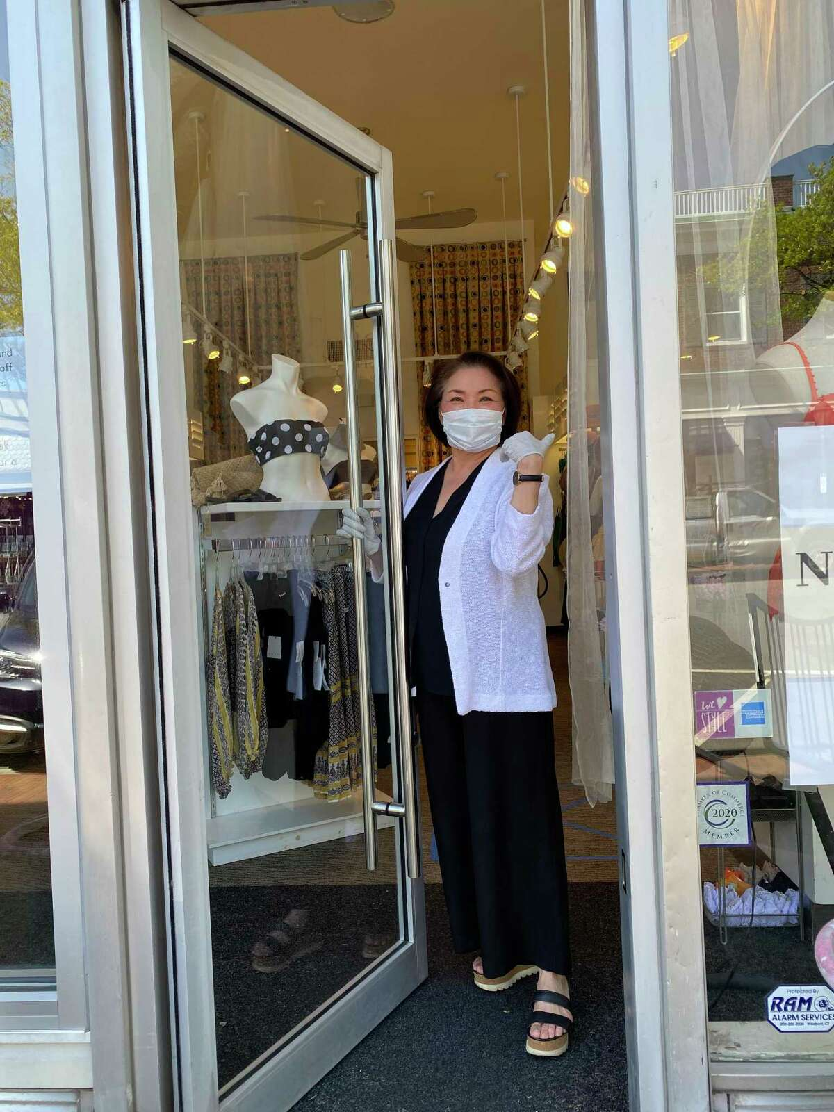 Susan Langford welcomes customers back to Soleil Toile, which was among the downtown New Canaan stores reopening on Wednesday, May 20, after being closed for some 10 weeks due to COVID-19.
