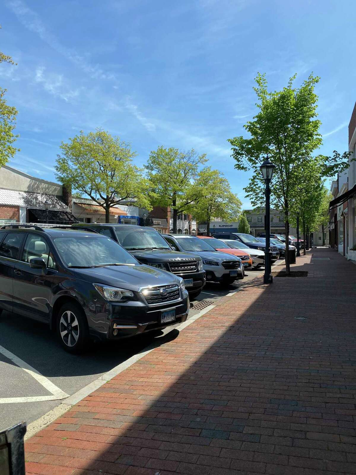 Since stores have re-opened up their interiors, and restaurants re-opened with outdoor dining in New Canaan, residents finding a place to put their vehicles has increased for business.