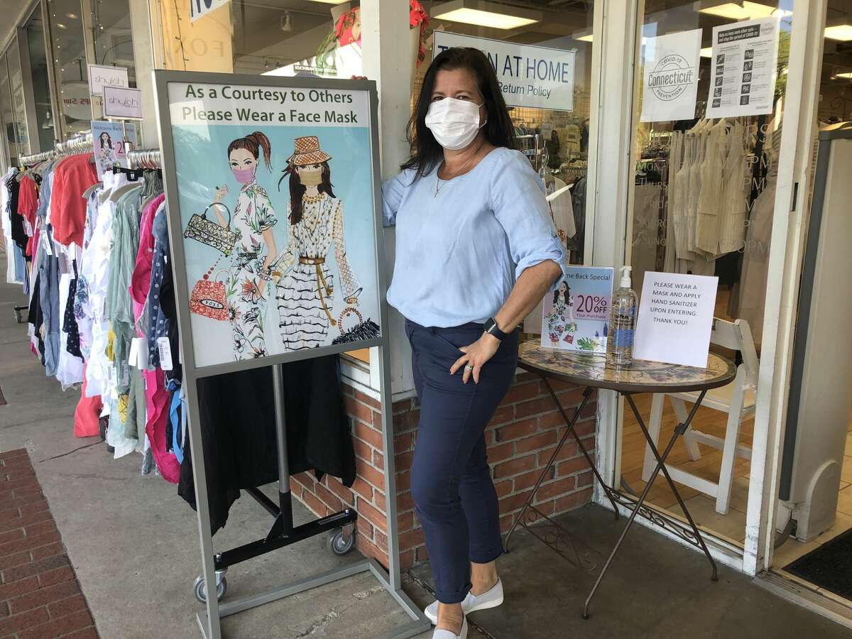 At Fox's, a discounted designer boutique in Turn of River, manager Elizabeth Correa has changed her returns policy to make clothes shopping easier and safer.