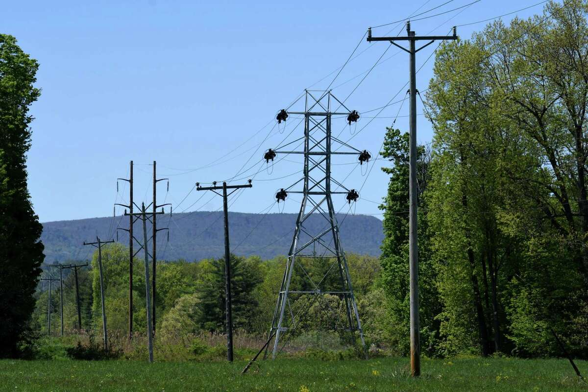 Power line run through a field near Bethlehem High School on Wednesday, May, 20, 2020, on Van Dyke Road in Bethlehem, N.Y. National Grid is proposing to build substation in farmland near Van Dyke Road. (Will Waldron/Times Union)