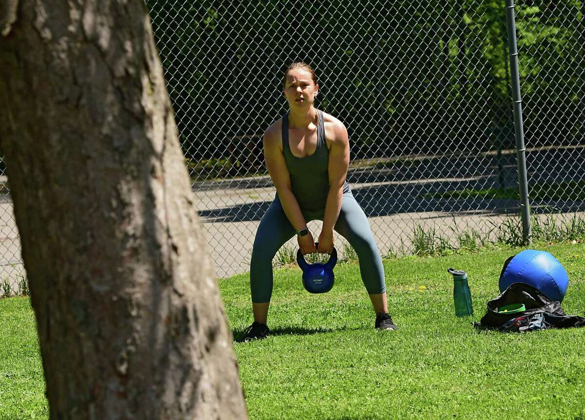 Kaitlyn Budge of Schenectady works out in her personal outdoor gym in Central Park on Wednesday, May 20, 2020 in Schenectady, N.Y. Budge recently moved her from Syracuse. Gyms have been closed since the COVID-19 outbreak. (Lori Van Buren/Times Union)