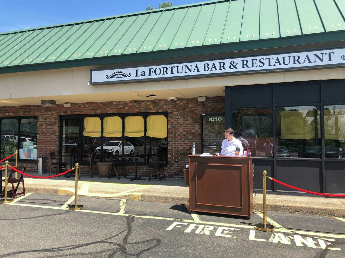 La Fortuna Bar and Restaurant in Stratford added glass partitions at tables as added precaution as customers can dine in for the first time in two months.